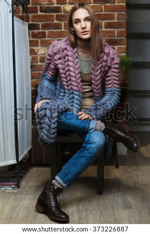 Model posing in knitted jacket