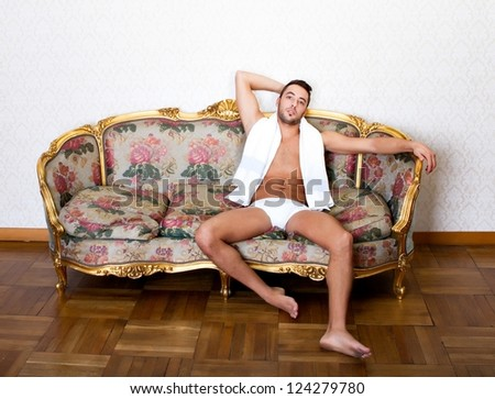 model relaxing in a living room