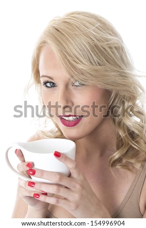 Model Released. Attractive Young Woman Drinking Coffee - stock photo