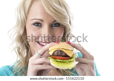 Model Released. Attractive Young Woman Eating a Cheeseburger