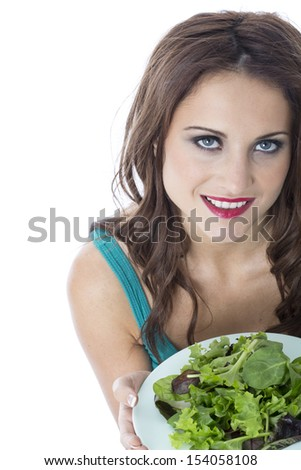Model Released. Attractive Young Woman Eating Green Leafed Salad
