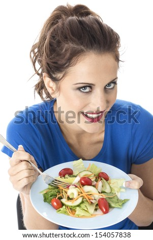 Model Released. Attractive Young Woman Eating Mixed Salad
