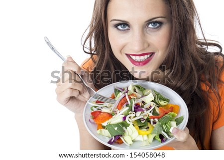 Model Released. Attractive Young Woman Eating Stir Fried Vegetables