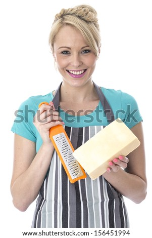 Model Released. Attractive Young Woman Grating Cheese
