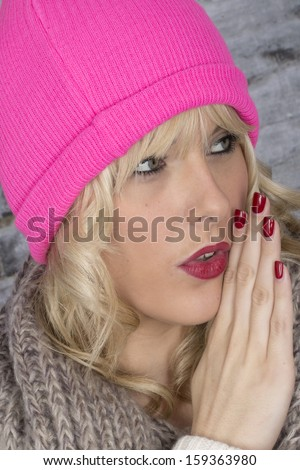 Model Released. Attractive Young Woman Whispering - stock photo