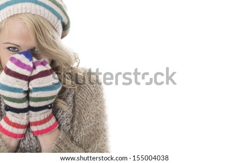 Model Released. Cold Young Woman Wearing a Wool Hat and Gloves