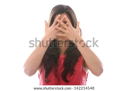 Model Released. Young Woman Hiding behind Hands