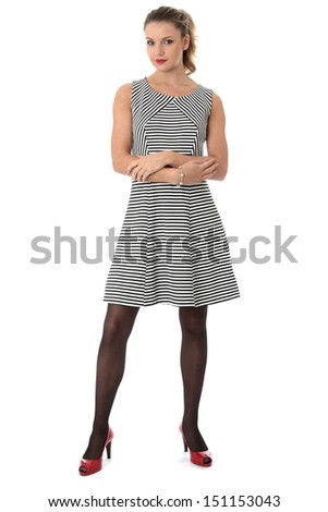 Model Released. Young Woman Modeling a Short Mini Dress