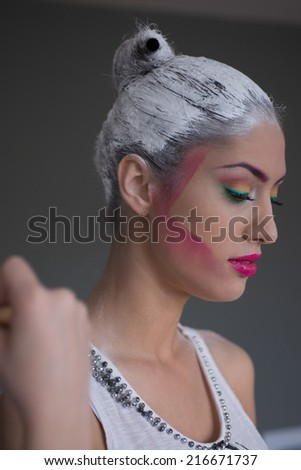 Model's portrait while  make up aplication