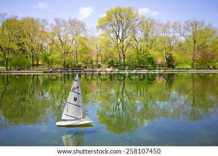 Model sailboat on lake in Central Park in Manhattan  - stock photo