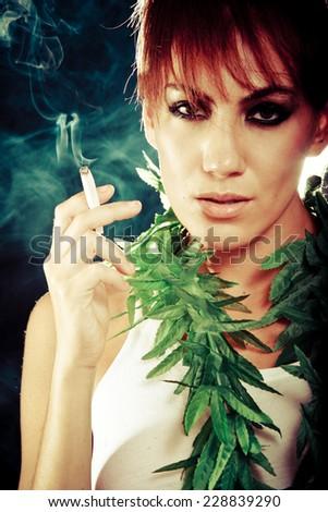 Model smoking - stock photo