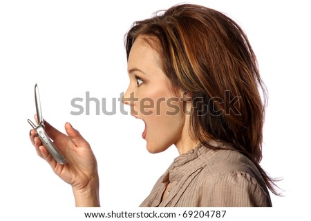 model surprised at something on her cell phone - stock photo