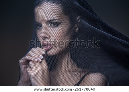 Model under the black grid with small units - stock photo