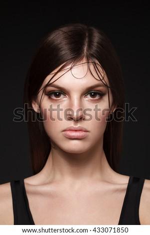 Model with Beauty face make up. Big Lips. Eyelashes extensions. Perfect Make-up closeup. Foundation. Color. Beauty Girl with Perfect Skin. Eyelashes. Brunette hair. Stylish. - stock photo