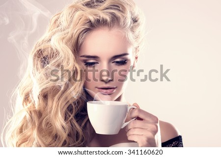 Model with coffee cup, mug in coffee shop. Fashion Woman, tea party time. Blonde girl, tea set - stock photo