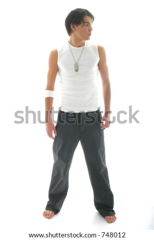 Model with jeans and white shirt looking leftwards - stock photo