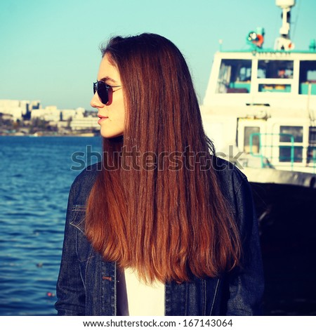 Model with long hair in sunglasses having fun. Lifestyle - stock photo