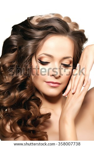 Model with long hair. Waves Curls Hairstyle. Hair Salon. Updo. Fashion model with shiny hair. Woman with healthy hair girl with luxurious haircut. Hair loss Girl with hair volume.  - stock photo