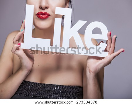 Model woman with red lips with white letters LIKE in the hands - stock photo