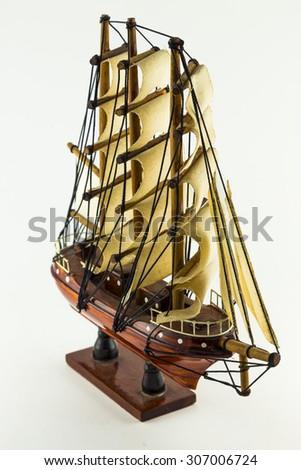 Model wooden ship isolated on white background. - stock photo