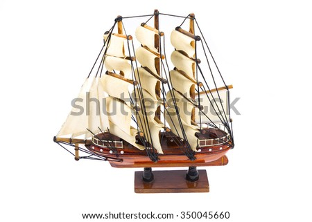 Model wooden ship isolated on white background.