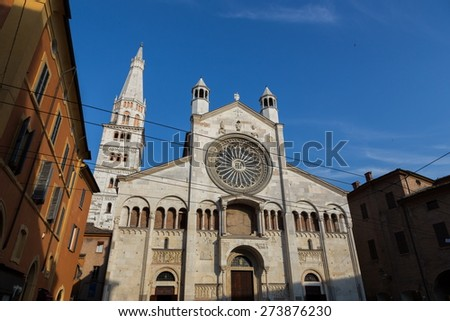 Modena, Cathedral: the main facade with gothic rose window - stock photo