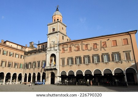 MODENA, ITALY - APRIL 1, 2014: Market square of Modena on April 1, 2014 in Modena, Italy. Parma is a popular unesco world heritage city in the province of Emilia-Romagna. - stock photo