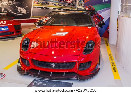 MODENA, ITALY - APRIL 2015: Museum  Enzo Ferrari Modena. Red Ferrari 599 XX 2009 with The Cavallino Rampante, symbol of Ferrari on. Front view.