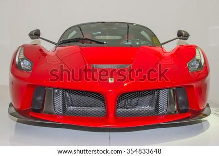 MODENA, ITALY - APRIL 2015: Museum  Enzo Ferrari Modena. Red La Ferrari 2013 with The Cavallino Rampante, symbol of Ferrari on. Front view. - stock photo