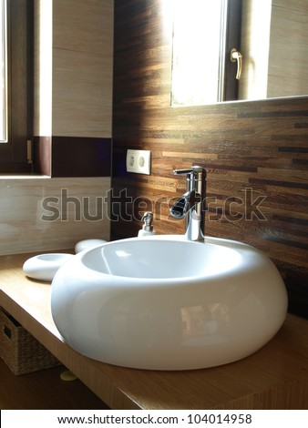 Moder bathroom interior: original white sink - stock photo