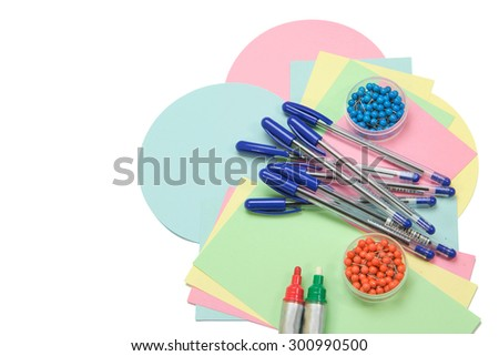 Moderator accessories are spreading out on an isolated white background. (Colorful circular and rectangular paper, pens, pins and colorful stick-on labels) All potential trademarks are removed. - stock photo