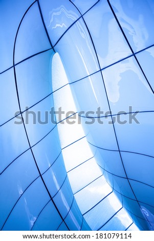 Modern abstract ceiling in blue vertical view - stock photo