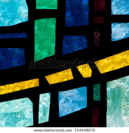 Modern abstract stained glass window made of colored slab glass - stock photo