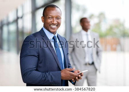 modern african american businessman using cell phone - stock photo