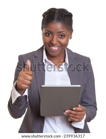 Modern african businesswoman working with tablet computer