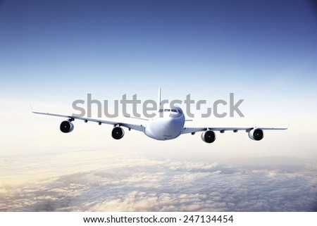 Modern Airplane flying in the sky.