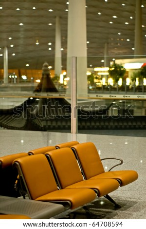 Modern airport interior with chairs. - stock photo