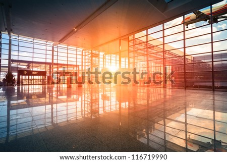 modern airport terminal and flight in shanghai - stock photo