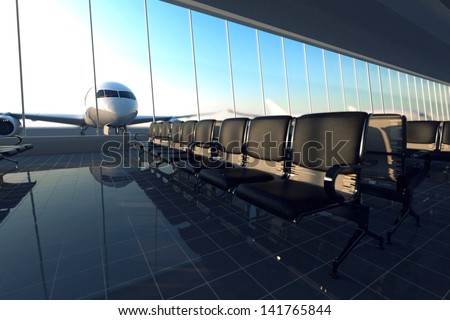 Modern airport terminal with black leather seats on a sunny morning. A huge viewing glass facade with a passenger aircraft behind it. - stock photo
