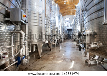 Modern aluminum barrels for wine - stock photo