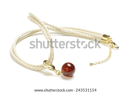 Modern amber bijouterie isolated on the white background - stock photo