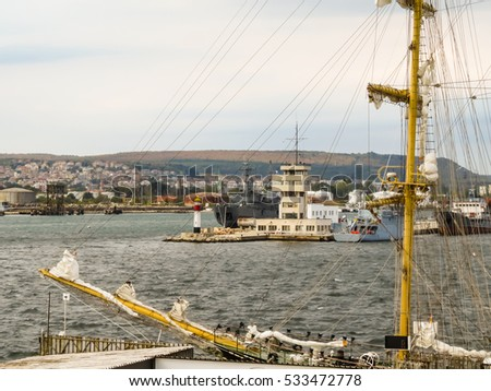 Modern and ancient ships in the harbour of the Sea Port Varna, Bulgaria