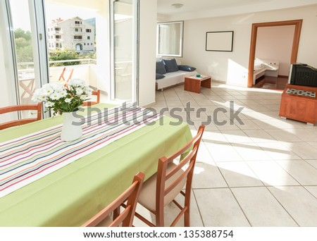 Modern and bright living room interior in house - stock photo