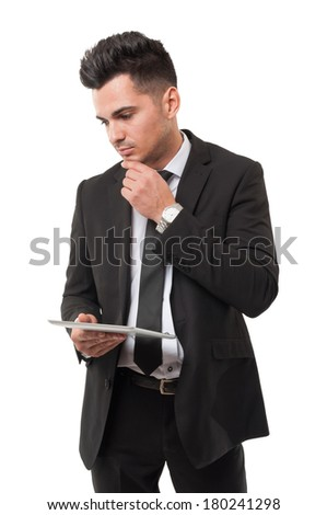 Modern and elegant business man analyzing new datas from his digital tablet