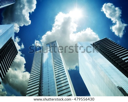 Modern and futuristic commercial business building with blue sky background from street point of view