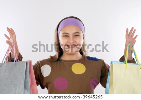 Modern and happy little girl with shopping bags