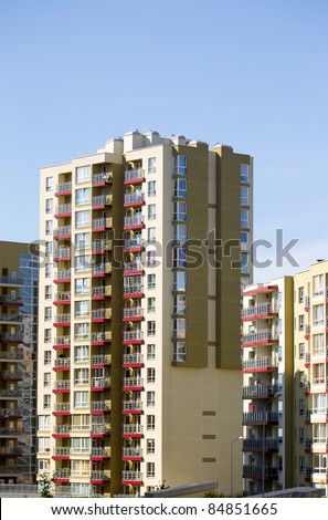 Modern and new apartment building. Multistoried modern, new and stylish living block of flats. Real estate. New house.Newly built block of flats. - stock photo