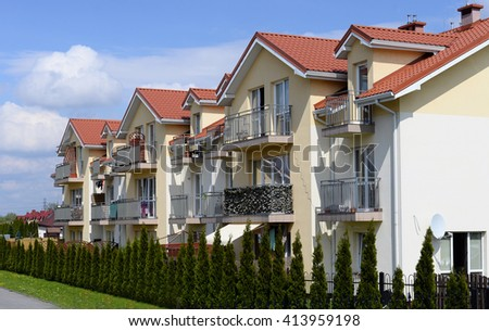 Modern and new apartment building, stylish living block of flats. Real estate. - stock photo