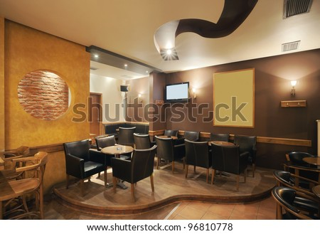 Modern and simple cafe interior with wooden classical furniture. - stock photo