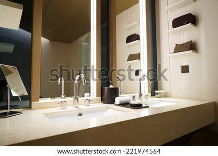Modern and spacious bathroom suite designed with luxury - stock photo